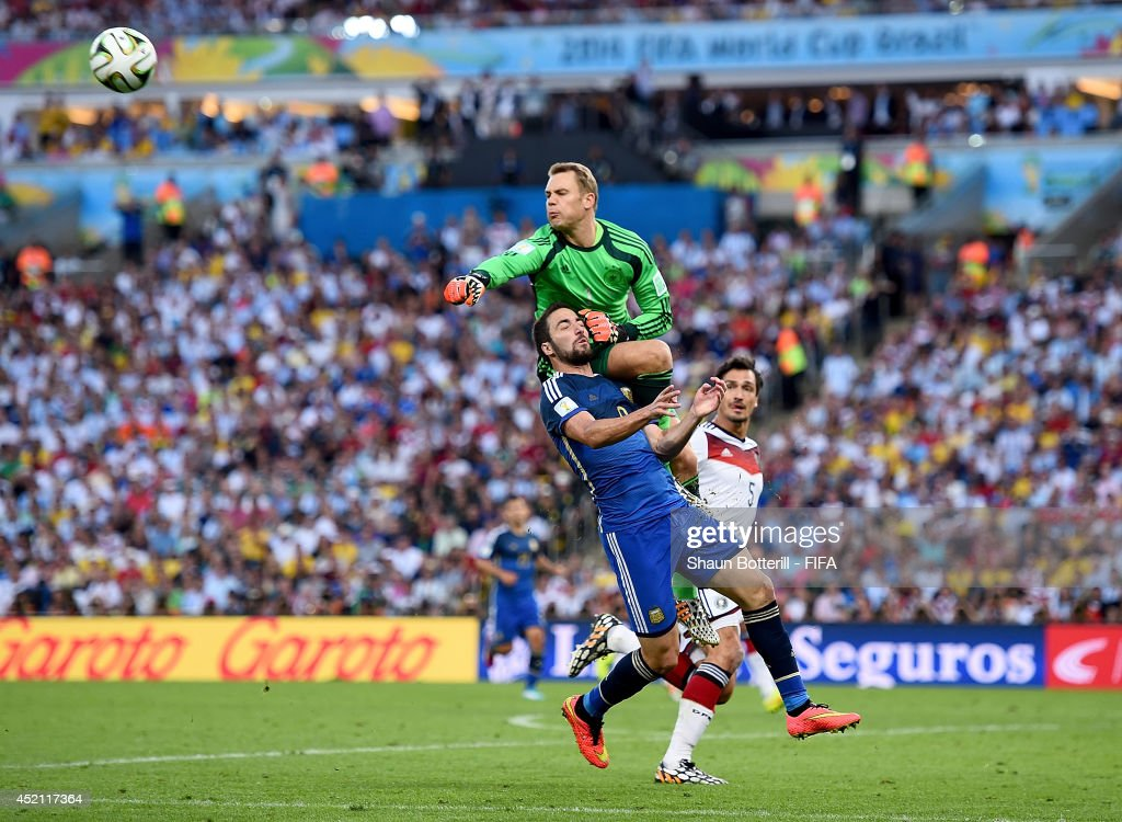 Gonzalo Higuain of Argentina and Manuel Neuer of Germany collide during the 2014 FIFA World Cup Brazil Final match between Germany and Argentina at Maracana on July 13, 2014 in Rio de Janeiro, Brazil.