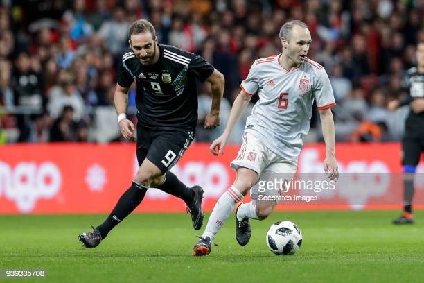 Gonzalo Higuain of Argentina Andres Iniesta of Spain during the International Friendly match between Spain v Argentina at the Estadio Wanda...