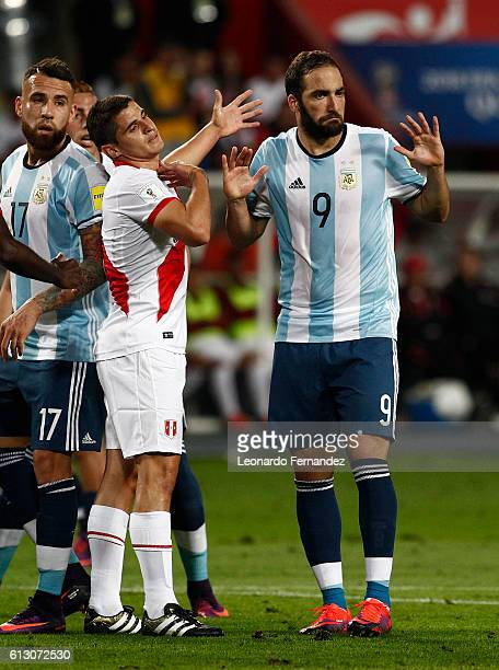 Gonzalo Higuain of Argentina argues with Aldo Corzo of Peru during a match between Peru and Argentina as part of FIFA 2018 World Cup Qualifiers at...