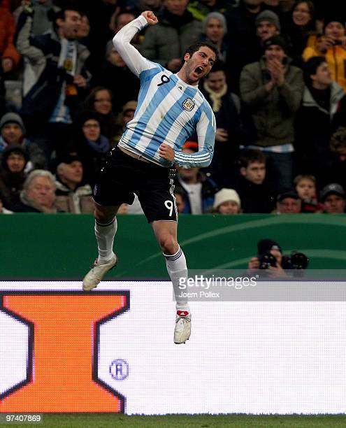 Gonzalo Higuain of Argentina celebrates after scoring his team's first goal during the International Friendly match between Germany and Argentina at...
