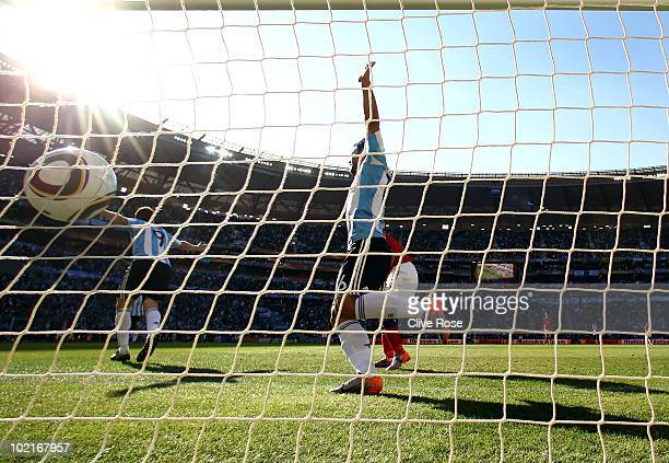 Gonzalo Higuain of Argentina celebrates scoring his second goal with team mate Sergio Aguero during the 2010 FIFA World Cup South Africa Group B...
