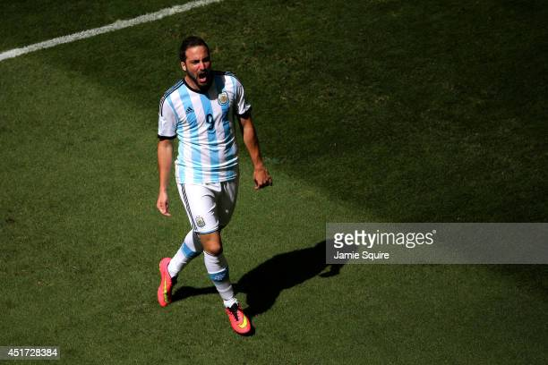Gonzalo Higuain of Argentina celebrates scoring his team's first goal during the 2014 FIFA World Cup Brazil Quarter Final match between Argentina and...