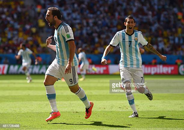 Gonzalo Higuain of Argentina celebrates scoring his team's first goal with Angel di Maria during the 2014 FIFA World Cup Brazil Quarter Final match...