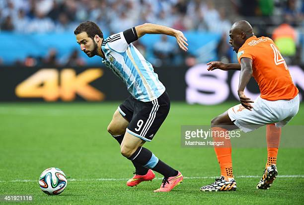Gonzalo Higuain of Argentina controls the ball against Bruno Martins Indi of the Netherlands during the 2014 FIFA World Cup Brazil Semi Final match...