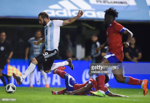 Gonzalo Higuain of Argentina fights for the ball with Alex Christian of Haiti during an international friendly match between Argentina and Haiti at...