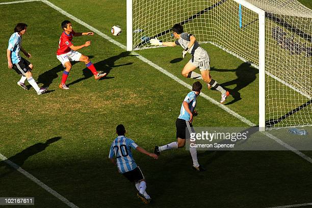 Gonzalo Higuain of Argentina heads in his third goal and his side's fourth during the 2010 FIFA World Cup South Africa Group B match between...