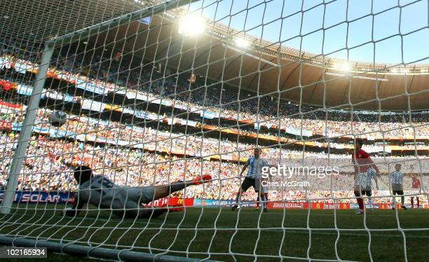 Gonzalo Higuain of Argentina heads the ball past Jung SungRyong of South Korea to score his side's second goal during the 2010 FIFA World Cup South...