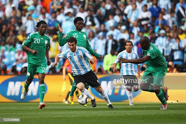 Gonzalo Higuain of Argentina is challenged by Dickson Etuhu Ayodele Adeleye and Danny Shittu of Nigeria during the 2010 FIFA World Cup South Africa...