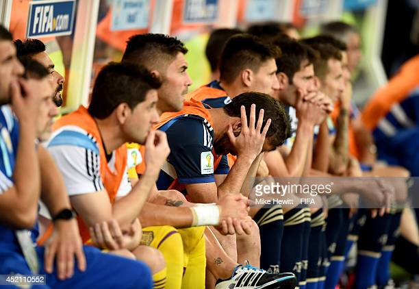 Gonzalo Higuain of Argentina is seen on the bench after Germany's first goal during the 2014 FIFA World Cup Brazil Final match between Germany and...