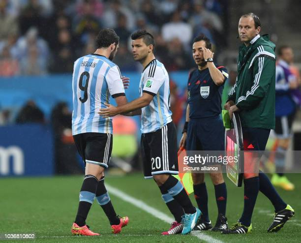 Gonzalo Higuain of Argentina is substituted for Sergio Aguero during the FIFA World Cup 2014 semifinal soccer match between the Netherlands and...