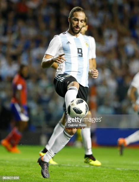 Gonzalo Higuain of Argentina kicks the ball during an international friendly match between Argentina and Haiti at Alberto J Armando Stadium on May 29...