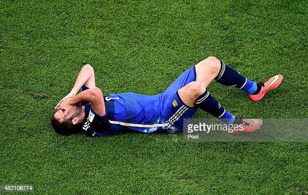 Gonzalo Higuain of Argentina lies on the pitch after a collision during the 2014 FIFA World Cup Brazil Final match between Germany and Argentina at...