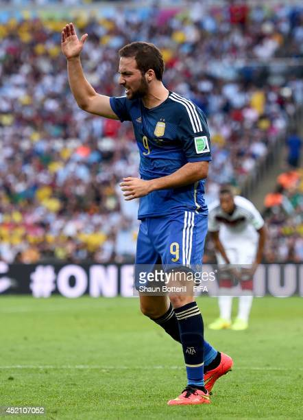 Gonzalo Higuain of Argentina reacts after a collision during the 2014 FIFA World Cup Brazil Final match between Germany and Argentina at Maracana on...