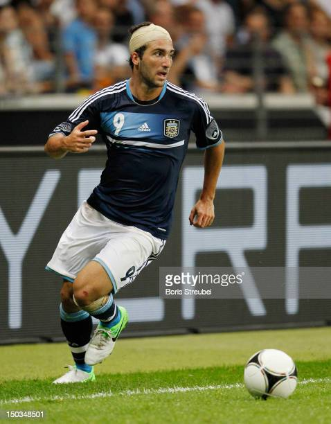 Gonzalo Higuain of Argentina runs with the ball during the international friendly match between Germany and Argentina at CommerzbankArena on August...