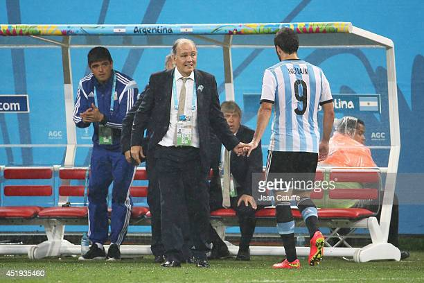 Gonzalo Higuain of Argentina salutes his head coach Alejandro Sabella as he leaves the field during the 2014 FIFA World Cup Brazil Semi Final match...