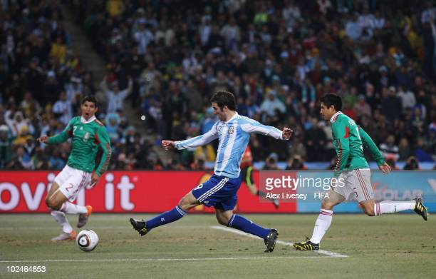 Gonzalo Higuain of Argentina scores during the 2010 FIFA World Cup South Africa Round of Sixteen match between Argentina and Mexico at Soccer City...
