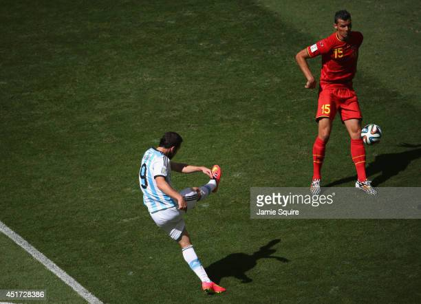 Gonzalo Higuain of Argentina scores his team's first goal against Daniel Van Buyten of Belgium during the 2014 FIFA World Cup Brazil Quarter Final...