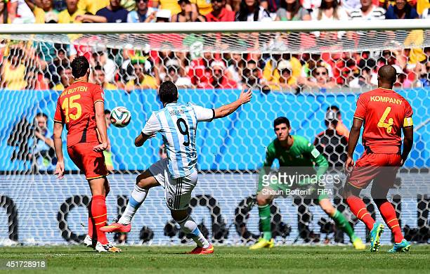 Gonzalo Higuain of Argentina scores his team's first goal during the 2014 FIFA World Cup Brazil Quarter Final match between Argentina and Belgium at...