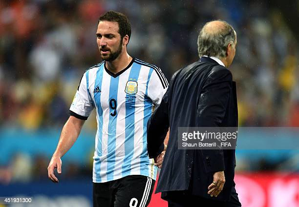Gonzalo Higuain of Argentina shakes hands with head coach Alejandro Sabella of Argentina as he is replaced during the 2014 FIFA World Cup Brazil Semi...