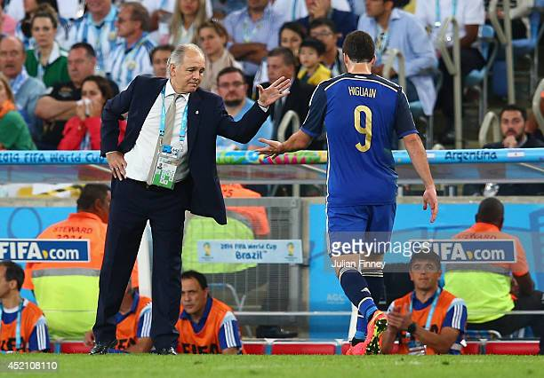 Gonzalo Higuain of Argentina shakes hands with head coach Alejandro Sabella as he exits the game during the 2014 FIFA World Cup Brazil Final match...