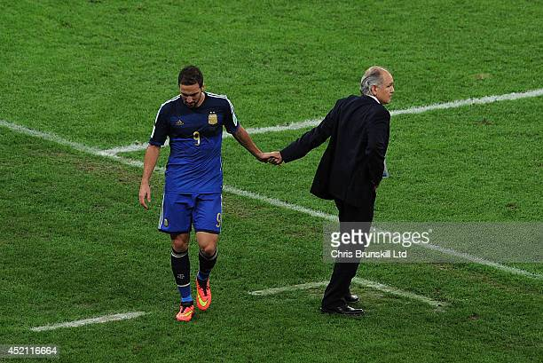 Gonzalo Higuain of Argentina shakes hands with manager Alejandro Sabella after being substituted during the 2014 World Cup Final match between...