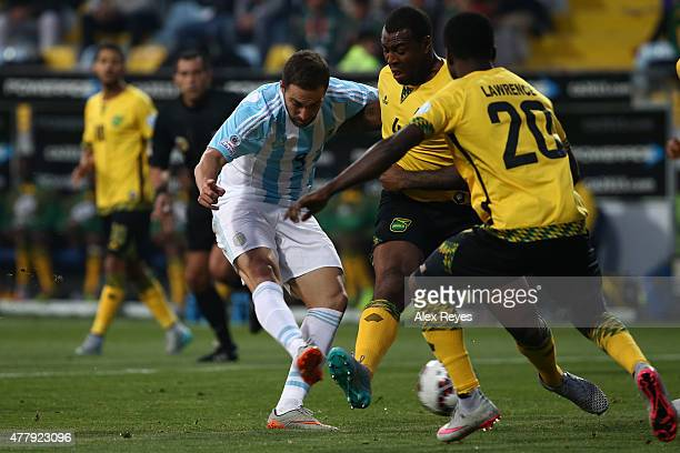 Gonzalo Higuain of Argentina shoots to score the opening goal during the 2015 Copa America Chile Group B match between Argentina and Jamaica at...