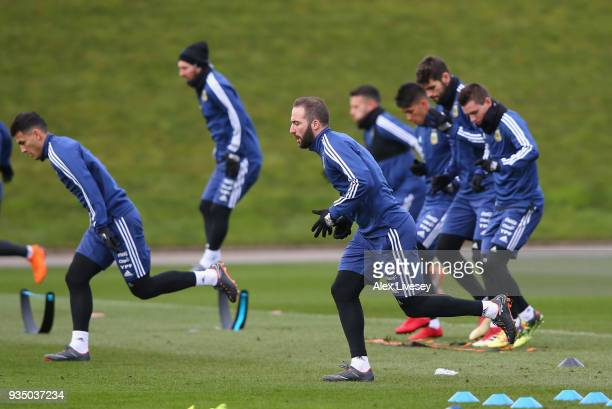 Gonzalo Higuain of Argentina sprints during a Argentina training session at Manchester City Football Academy on March 20 2018 in Manchester England