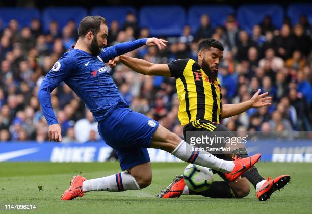Gonzalo Higuain of Chelisea s blocked by Adrian Mariappa of Watford during the Premier League match between Chelsea FC and Watford FC at Stamford...
