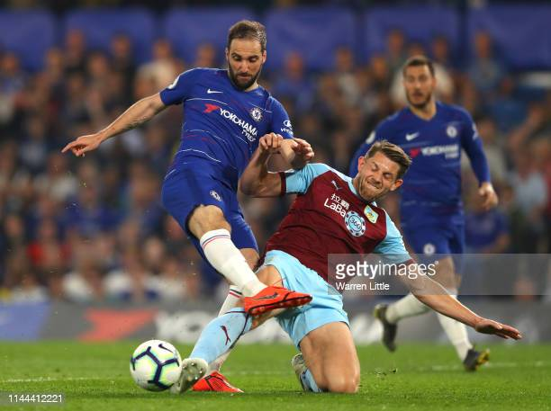 Gonzalo Higuain of Chelsea and James Tarkowski of Burnley clash during the Premier League match between Chelsea FC and Burnley FC at Stamford Bridge...