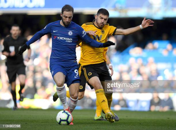 Gonzalo Higuain of Chelsea battles for possession with Ruben Neves of Wolverhampton Wanderers during the Premier League match between Chelsea FC and...