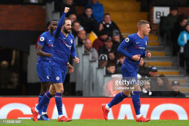 Gonzalo Higuain of Chelsea celebrates after scoring his sides first goal during the Premier League match between Fulham FC and Chelsea FC at Craven...