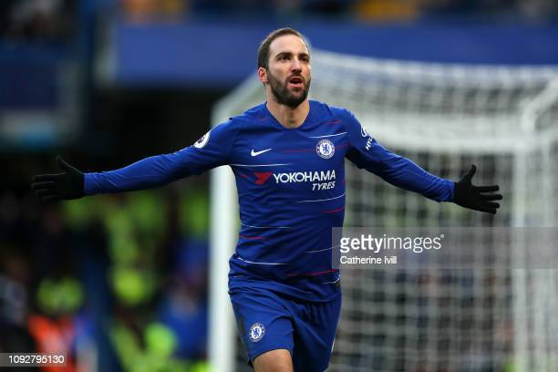 Gonzalo Higuain of Chelsea celebrates after scoring his team's first goal during the Premier League match between Chelsea FC and Huddersfield Town at...