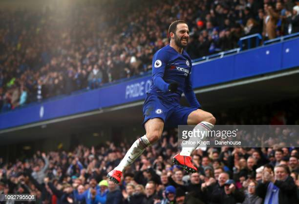 Gonzalo Higuain of Chelsea FC celebrates scoring his teams first goal during the Premier League match between Chelsea FC and Huddersfield Town at...