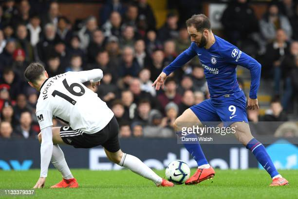 Gonzalo Higuain of Chelsea goes past Nordtveit of Fulham during the Premier League match between Fulham FC and Chelsea FC at Craven Cottage on March...