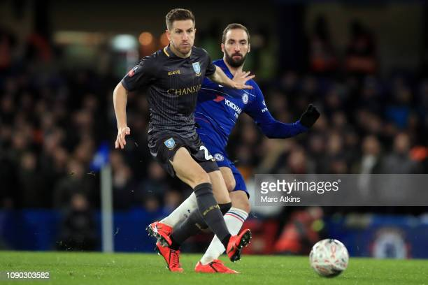 Gonzalo Higuain of Chelsea in action with Sam Hutchinson of Sheffield Wednesday during the FA Cup Fourth Round match between Chelsea and Sheffield...