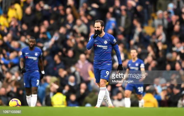 Gonzalo Higuain of Chelsea looks dejected after Manchester City score there fourth goal during the Premier League match between Manchester City and...