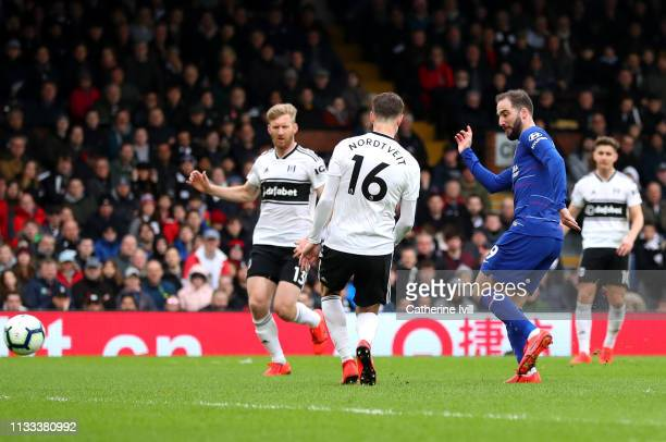 Gonzalo Higuain of Chelsea scores his sides first goal during the Premier League match between Fulham FC and Chelsea FC at Craven Cottage on March 03...