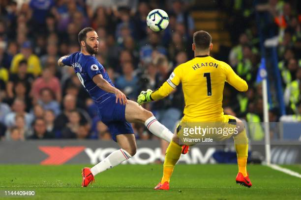 Gonzalo Higuain of Chelsea shoots past Tom Heaton of Burnley during the Premier League match between Chelsea FC and Burnley FC at Stamford Bridge on...