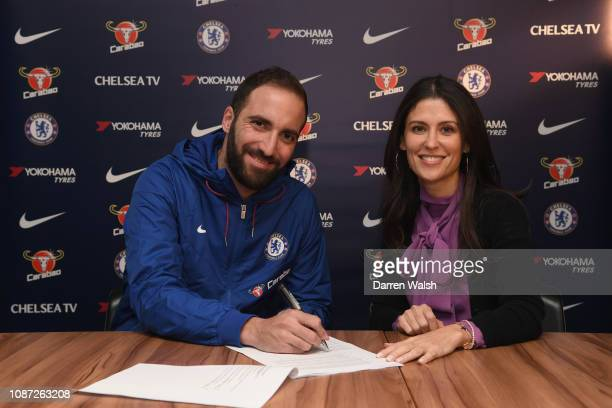 Gonzalo Higuain of Chelsea signs for Chelsea alongside Chelsea Director Marina Granovskaia at Stamford Bridge on January 23 2019 in London England