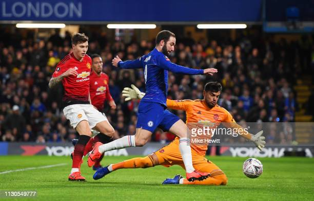 Gonzalo Higuain of Chelsea takes on Sergio Romero and Victor Lindelof of Manchester United during the FA Cup Fifth Round match between Chelsea and...