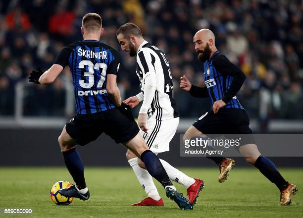 Gonzalo Higuain of FC Juventus in action against Milan Skriniar and Borja Valero of FC Internazionale during the Serie A football match between FC...