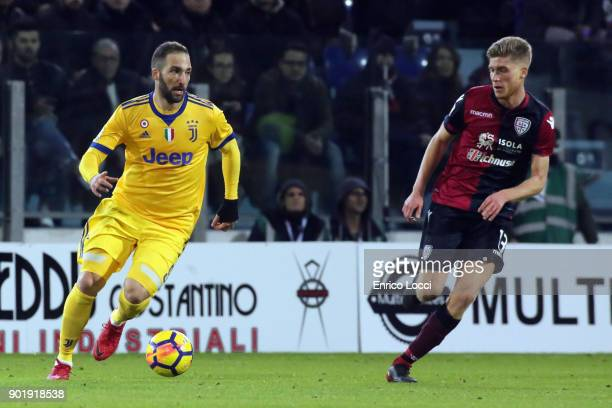 Gonzalo Higuain of Juventus and Filippo Romagna of Cagliari in contrast during the serie A match between Cagliari Calcio and Juventus at Stadio...