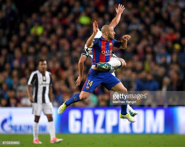 Gonzalo Higuain of Juventus and Javier Mascherano of Barcelona battle for possession during the UEFA Champions League Quarter Final second leg match...