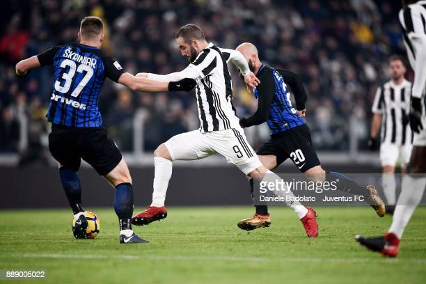 Gonzalo Higuain of Juventus and Milan Skriniar of FC Internazionale compete for the ball during the Serie A match between Juventus and FC...