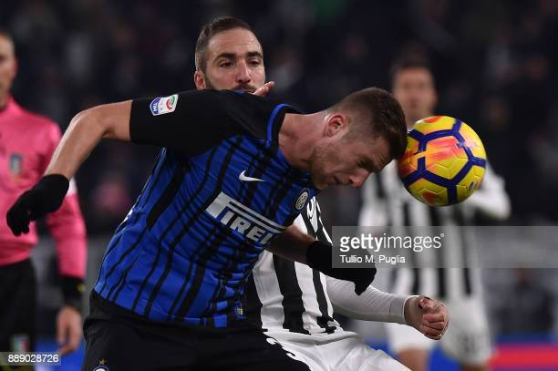 Gonzalo Higuain of Juventus and Milan Skriniar of Internazionale compete for the ball during the Serie A match between Juventus and FC Internazionale...