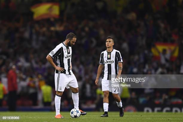 Gonzalo Higuain of Juventus and Paulo Dybala of Juventus look dejected during the UEFA Champions League Final between Juventus and Real Madrid at...