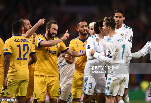 Gonzalo Higuain of Juventus argues with Cristiano Ronaldo of Real Madrid after the UEFA Champions League Quarter Final Second Leg match between Real...