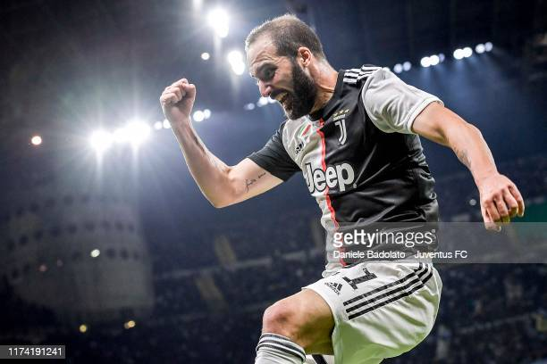 Gonzalo Higuain of Juventus celebrates after his goal during the Serie A match between FC Internazionale and Juventus at Stadio Giuseppe Meazza on...