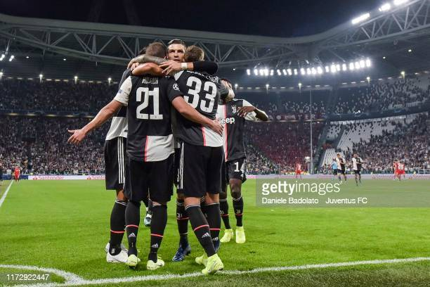 Gonzalo Higuain of Juventus celebrates after scoring his goal of 1-0 with teammates Cristiano Ronaldo and Federico Bernardeschi during the UEFA...