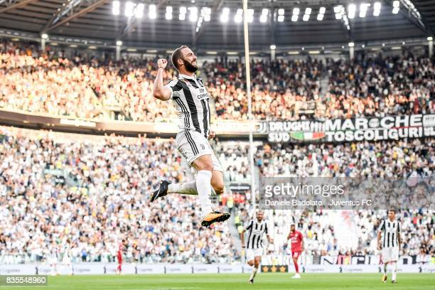 Gonzalo Higuain of Juventus celebrates after scoring his team third goal during the Serie A match between Juventus and Cagliari Calcio at Allianz...